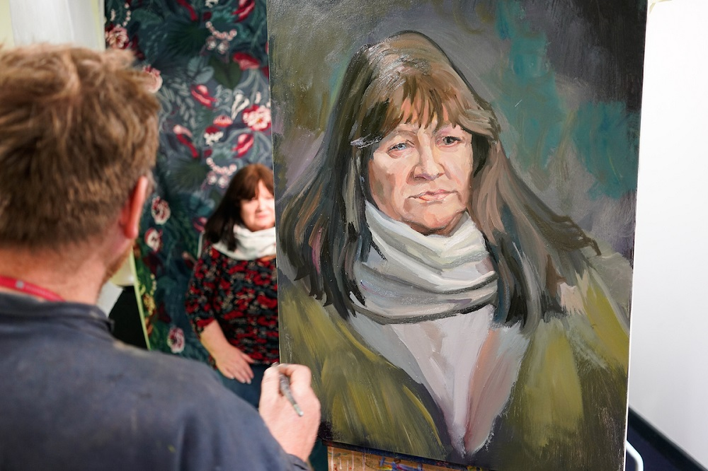 Philip Garrett painting Pam at Kirkby Gallery